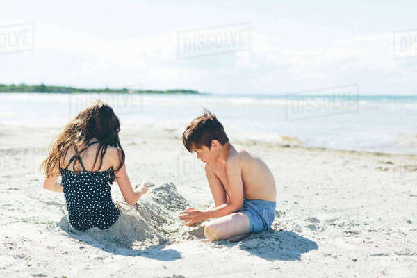 Sweden, Oland, Kopingsvik, Girl (10-11) and boy (8-9) playing in sand Royalty-free stock photo