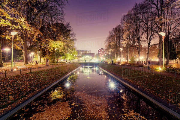 Sweden, Skane, Malmo, Illuminated canal in Folkets park at night Royalty-free stock photo