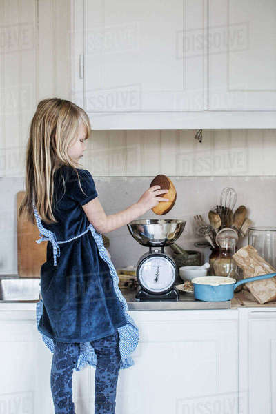 Sweden, Little girl (4-5) cooking Royalty-free stock photo