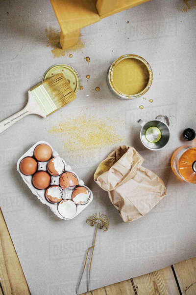 Sweden, Directly above view of paintbrush, wire whisk and cracked eggs Royalty-free stock photo