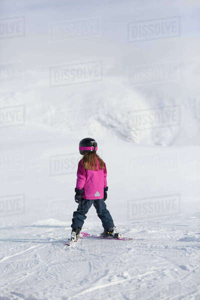 Sweden, Vasterbotten, Hemavan, Little girl (6-7) in ski wear standing on mountain slope Royalty-free stock photo
