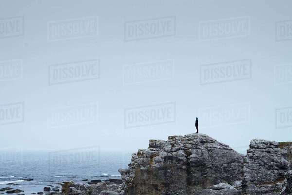 Sweden, Gotland, Woman standing on cliff Royalty-free stock photo