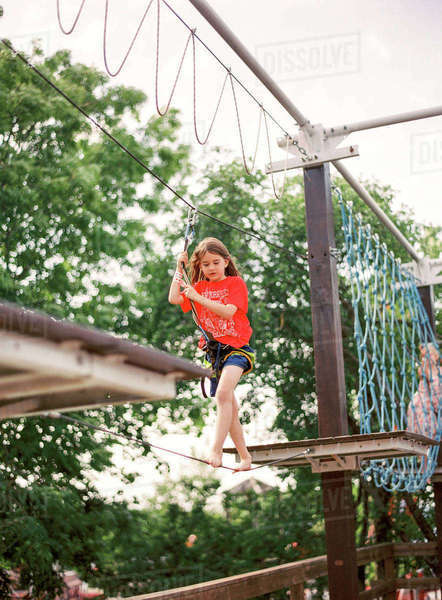 Sweden, Boy (8-9) walking on rope in adventure park Royalty-free stock photo