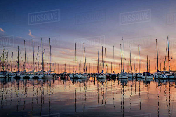 Sweden, Vastra Gotaland, Gothenburg, Yachts in marina at sunset Royalty-free stock photo