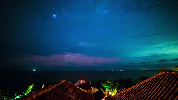 Timelapse. The Milky Way above the roofs of bungalows and Indian Ocean Royalty-free stock video