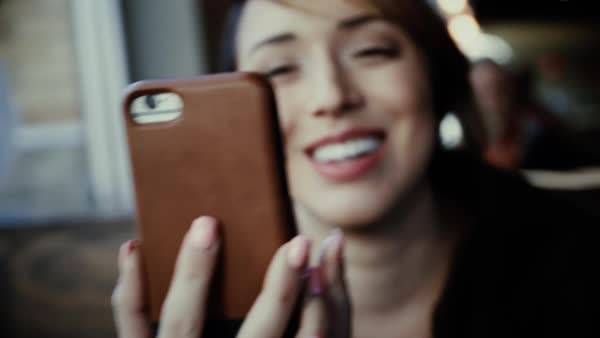 Hand-held shot of a woman making a video call with a smartphone Royalty-free stock video