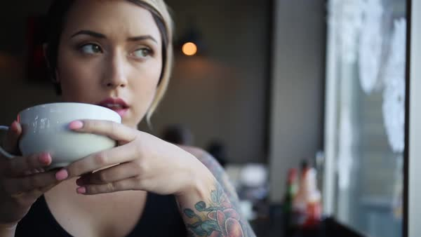 Zooming in shot of a woman drinking from a cup Royalty-free stock video