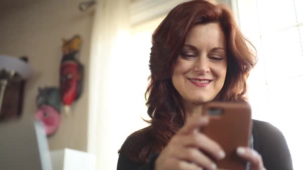 Panning shot view of a woman using a smartphone Royalty-free stock video