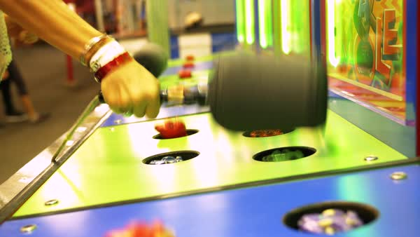 Hand-held shot of a person playing a whack-a-mole game Royalty-free stock video