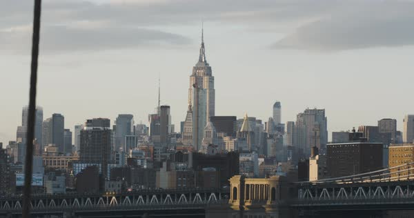 An establishing shot of New York City's Empire State Building at sunset Royalty-free stock video