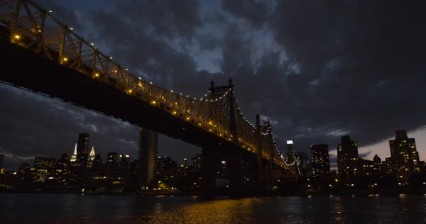 An establishing shot of New York City's Queensborough Bridge at night Royalty-free stock video