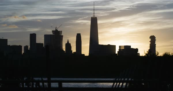 A silhouetted shot of New York City's Freedom Tower at sunset Royalty-free stock video