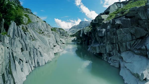 Aerial view of beautiful landscape with river, mountain and rocky nature with stones and rocks in Switzerland Royalty-free stock video