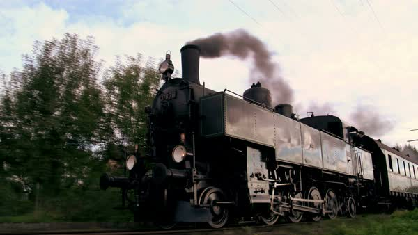 Old historical steam engine locomotive riding in slow motion on railroad. pastime technolgy scee Royalty-free stock video