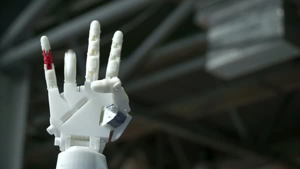 Close up shot of cybernetic robotic arm, controlled remotely. Royalty-free stock video