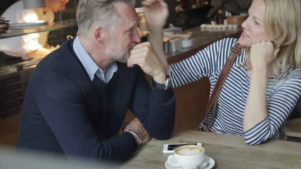A couple in a restaurant flirting Royalty-free stock video