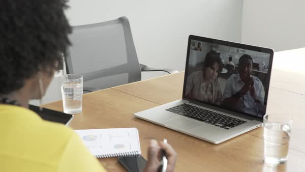 Hand-held shot of a woman using a digital tablet while having a video call conference Royalty-free stock video