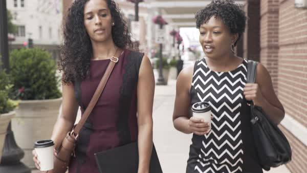 Tracking shot of two women walking on a street Royalty-free stock video