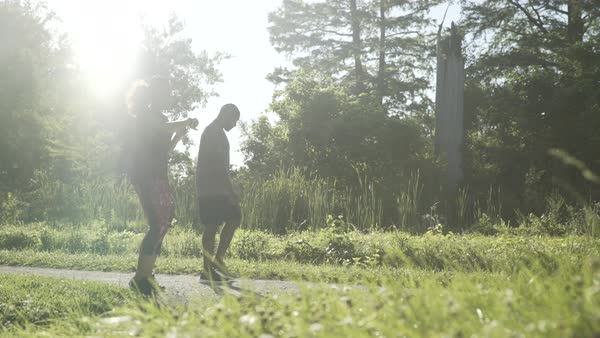 Hand held  shot of two people jogging in nature Royalty-free stock video