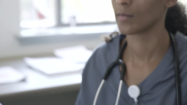 Hand held shot of a doctor working in a medical office Royalty-free stock video