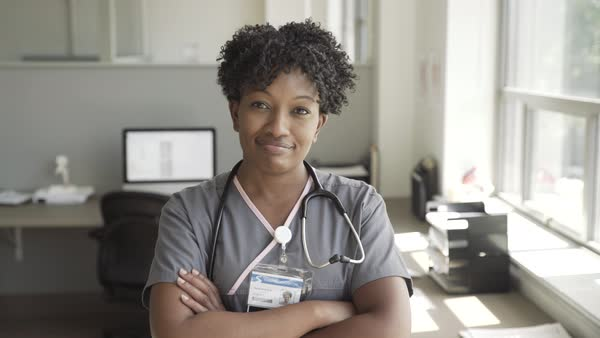 Hand held shot of a female doctor in medical office Royalty-free stock video