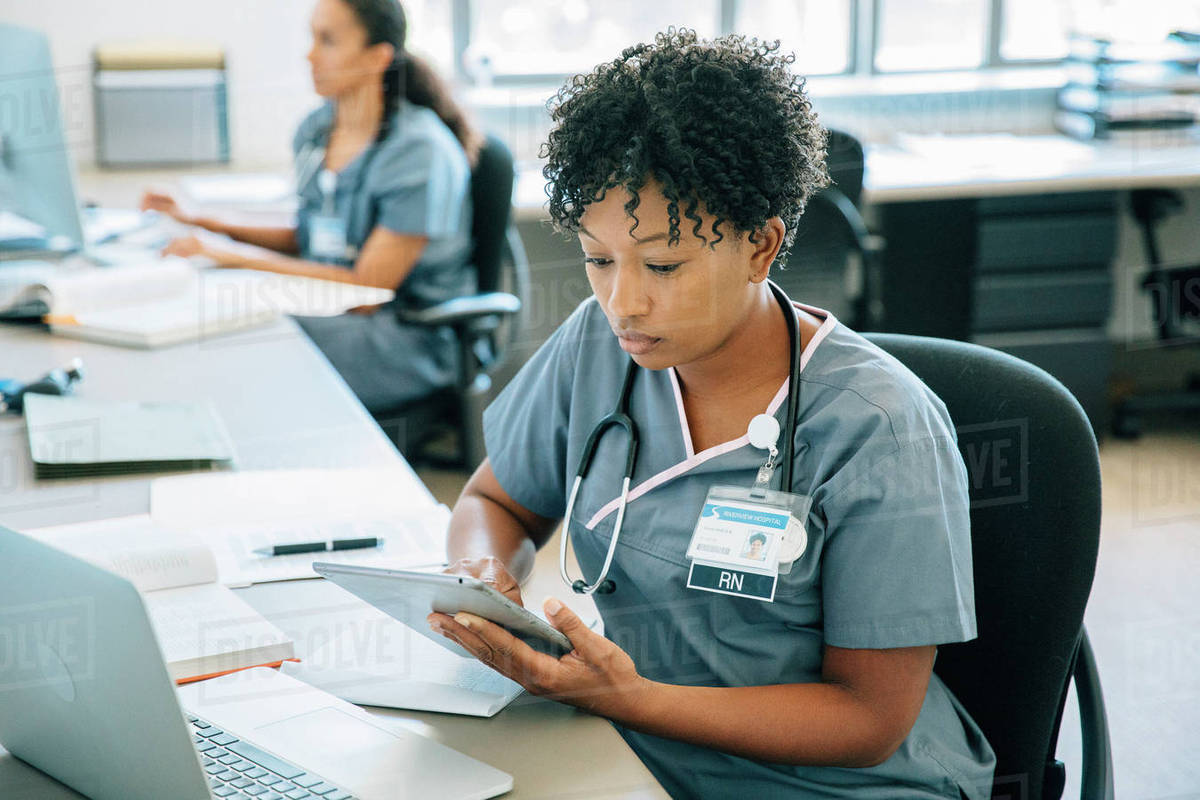 Nurse using digital tablet Royalty-free stock photo