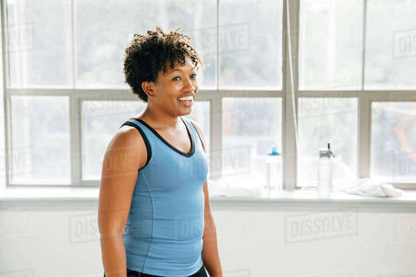 Smiling woman near window in exercise studio Royalty-free stock photo