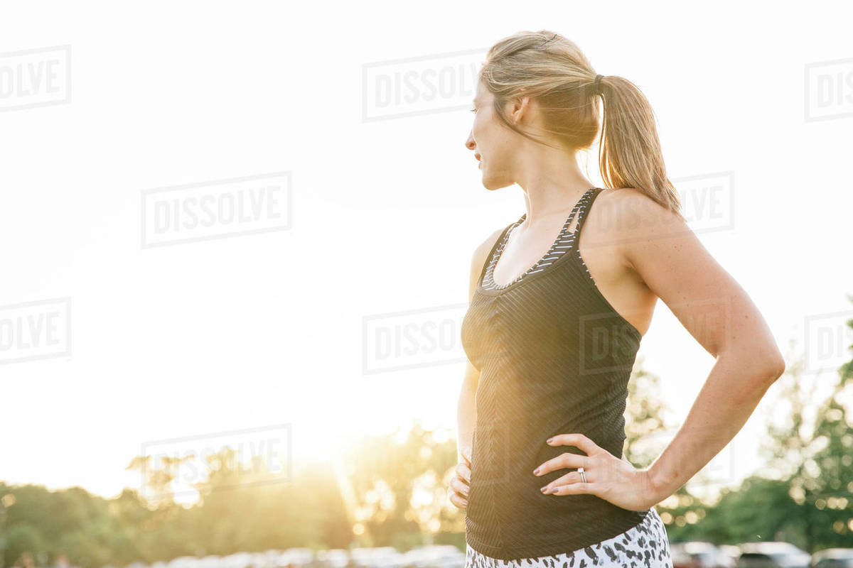 Woman standing outdoors with hands on hips Royalty-free stock photo