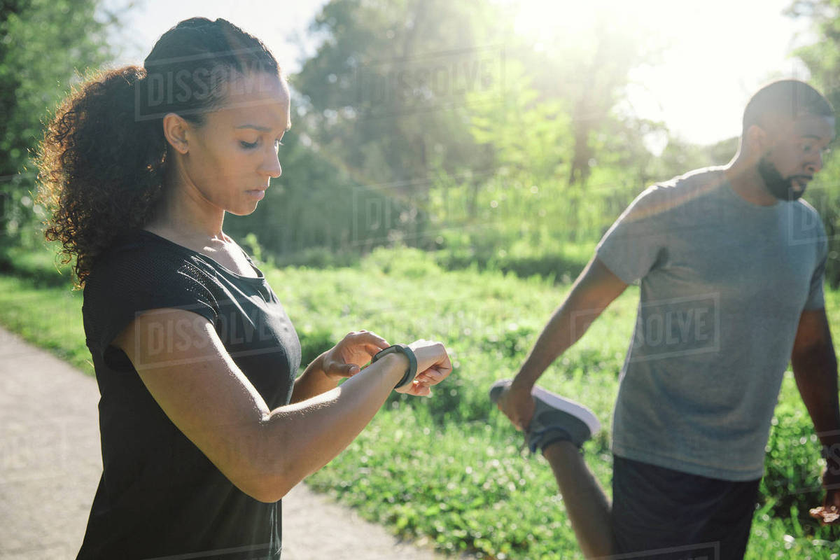 Couple preparing for running in park Royalty-free stock photo