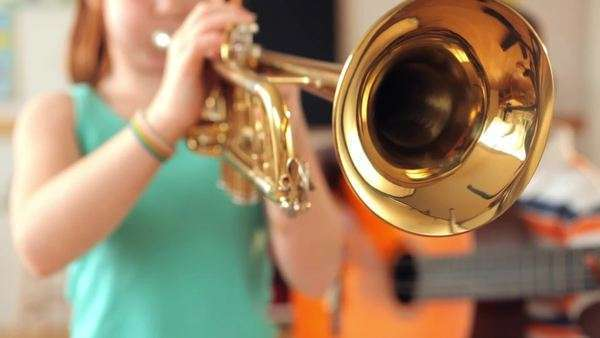Students playing guitar and trumpet in classroom Royalty-free stock video