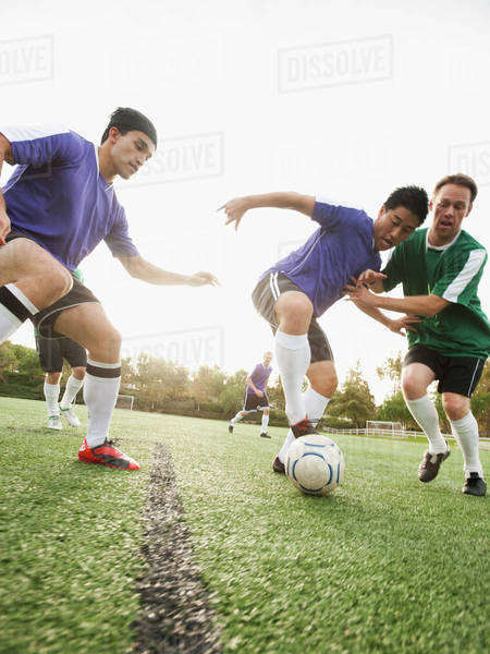 Men playing soccer on soccer field Royalty-free stock photo