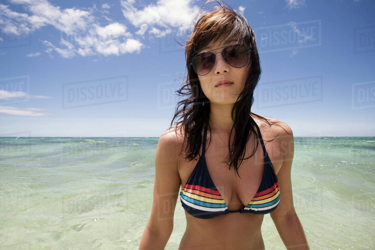 Korean Woman In Bikini With Ocean In Background Stock Photo Dissolve