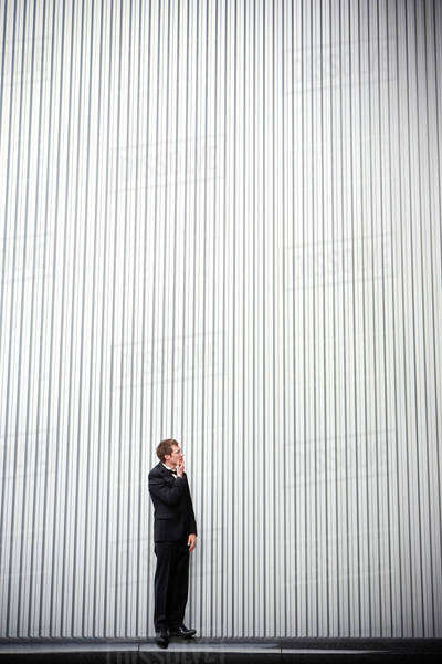 Uncertain groom standing near wall Royalty-free stock photo
