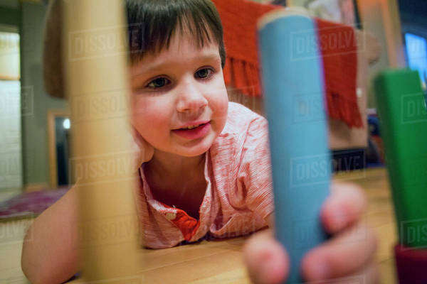 Caucasian boy playing with blocks on floor Royalty-free stock photo