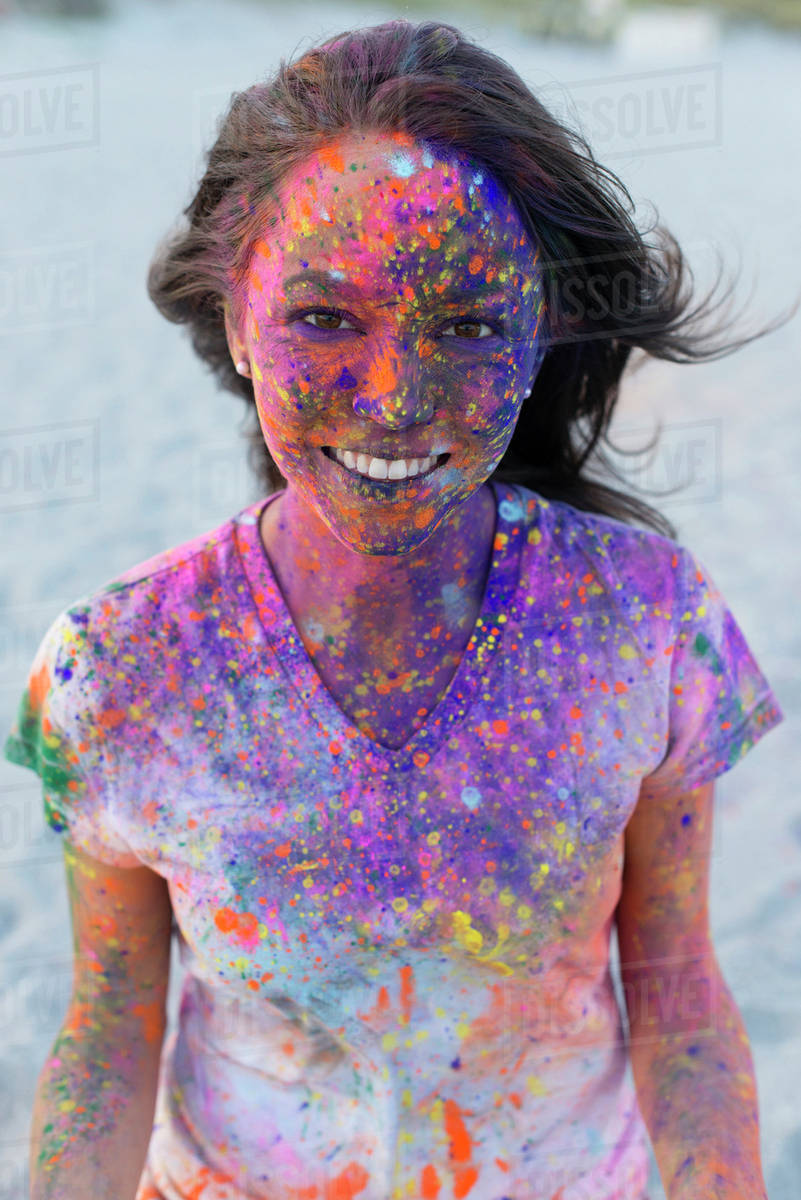 Caucasian woman splattered with paint powder Royalty-free stock photo