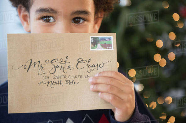 Mixed race boy holding letter to Santa for Christmas Royalty-free stock photo