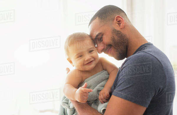 Father holding baby son Royalty-free stock photo