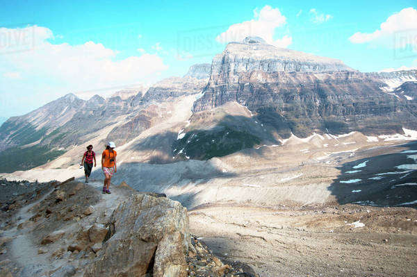 Caucasian mother and daughter hiking on Six Glaciers Trail, Banff, Alberta, Canada Royalty-free stock photo