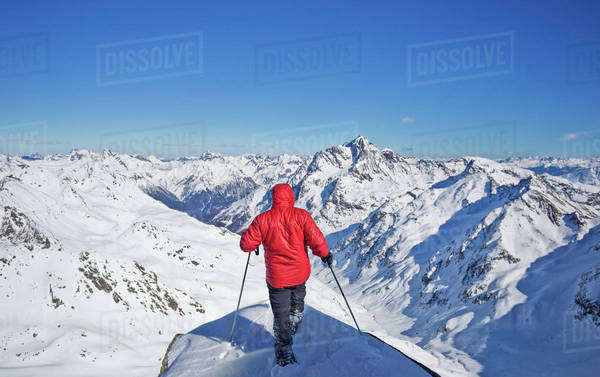 Caucasian man skiing on snowy mountaintop Royalty-free stock photo
