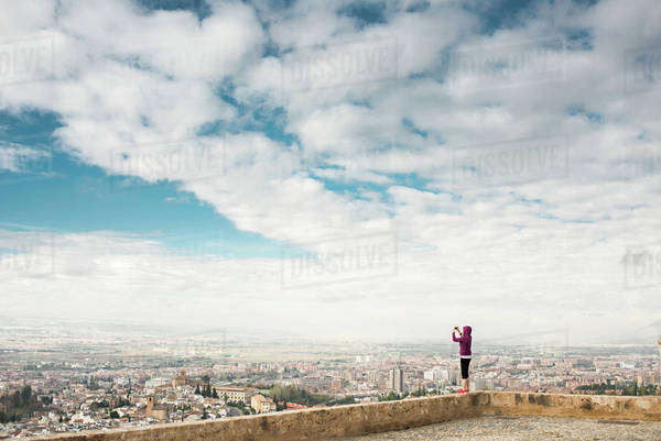Caucasian woman photographing scenic view of cityscape, Granada, Spain Royalty-free stock photo