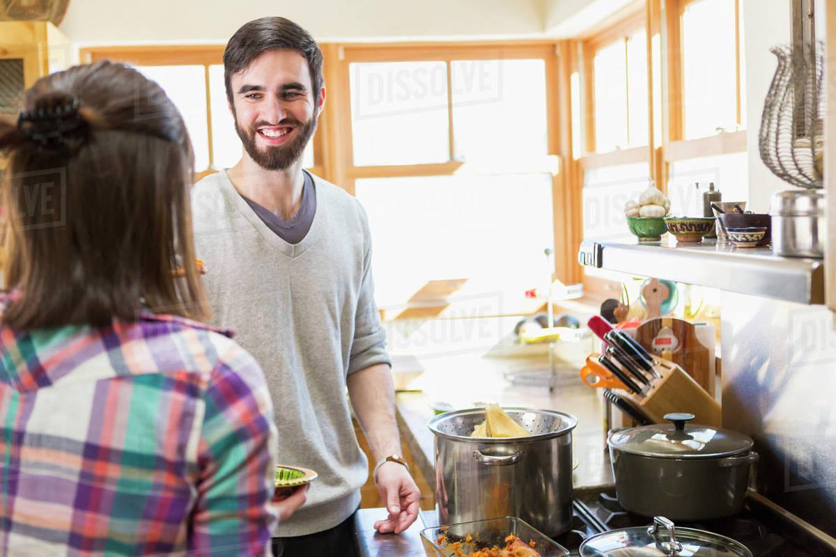 Hispanic couple cooking in kitchen - Stock Photo - Dissolve