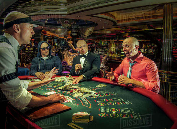 Multiple exposure of gamblers playing poker in casino Royalty-free stock photo