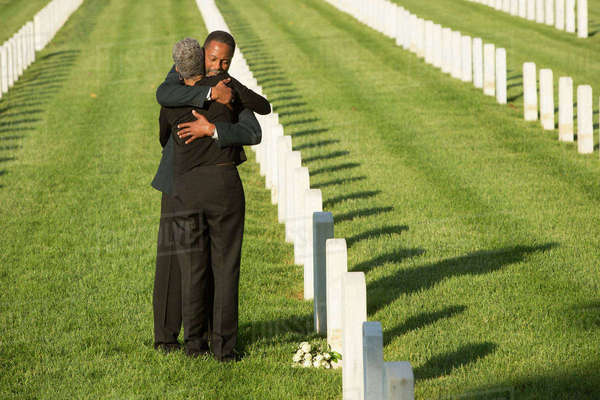Black couple hugging at military cemetery Royalty-free stock photo