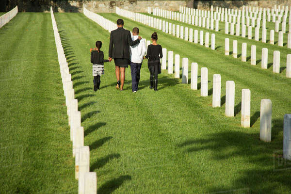 Black family walking in military cemetery Royalty-free stock photo