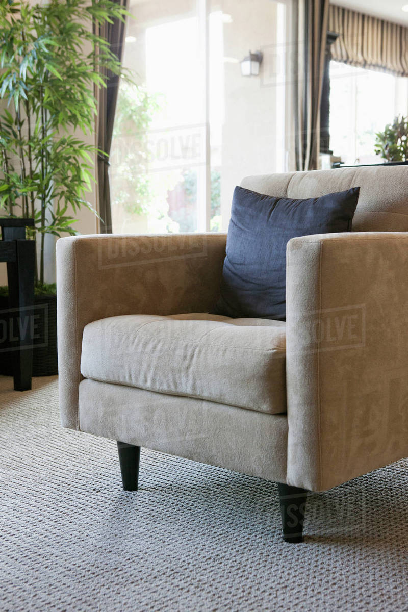 Cushion on comfortable armchair in living room