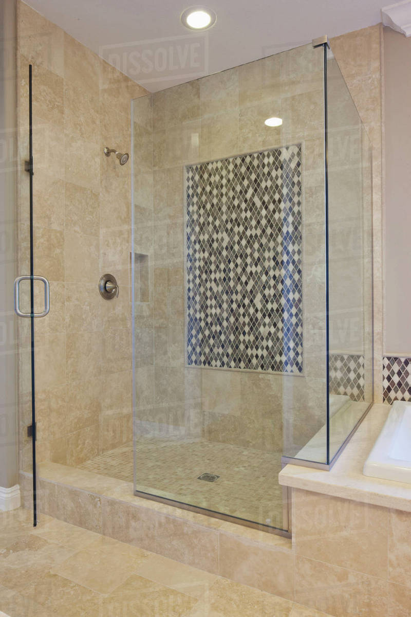 Glass shower cubicle in domestic room - Stock Photo - Dissolve