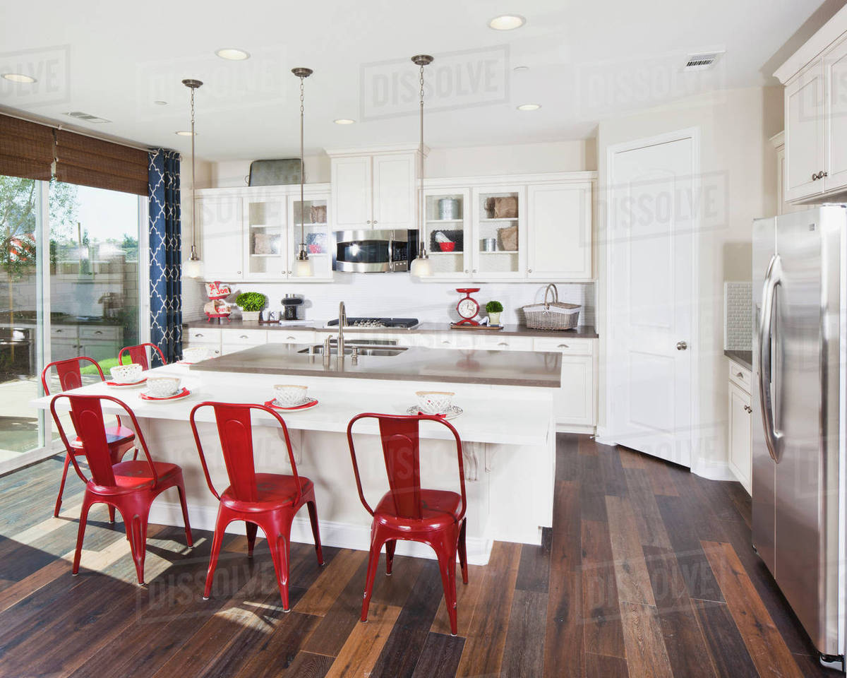Kitchen island with red bar stools in house D9 9 9