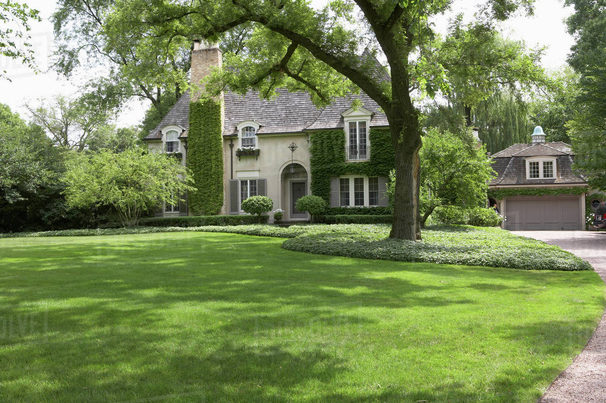 Ivy Covered French Normandy Style Home Angled View With Garage To Right Partial Driveway Shows Horizontal Stock Photo Dissolve