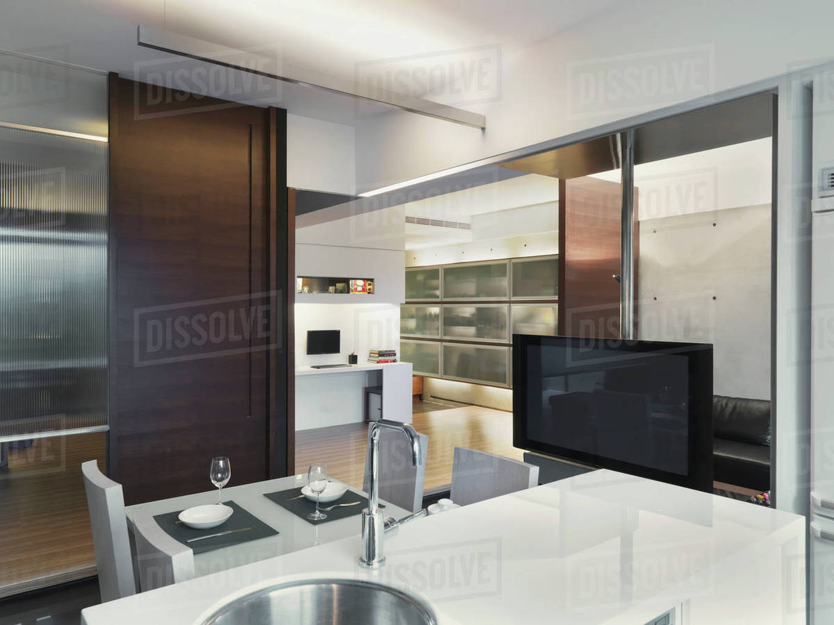 Open Modern Kitchen With Flat Screen Television