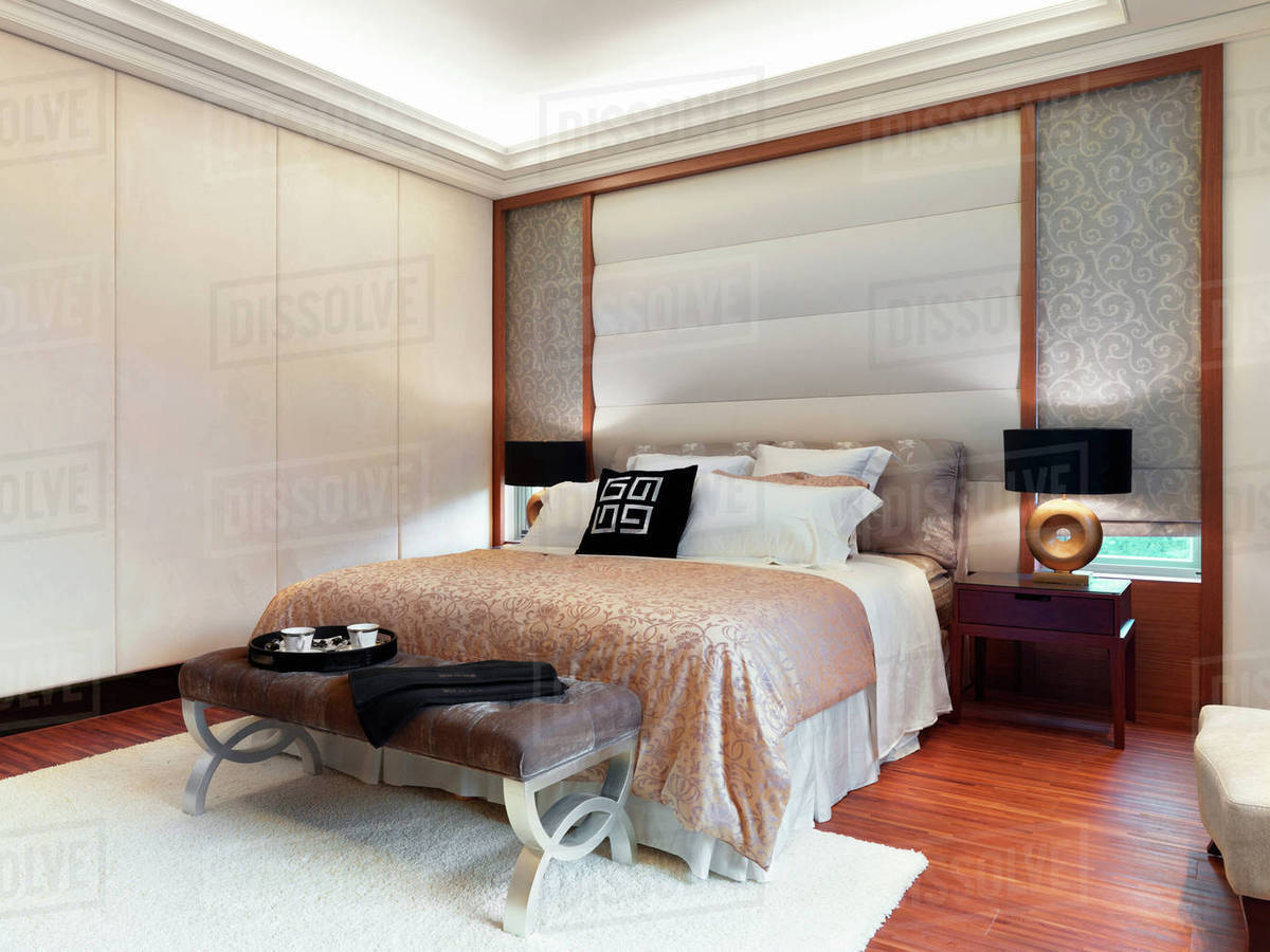 Bedroom With Hardwood Floor And White Carpet Stock Photo Dissolve